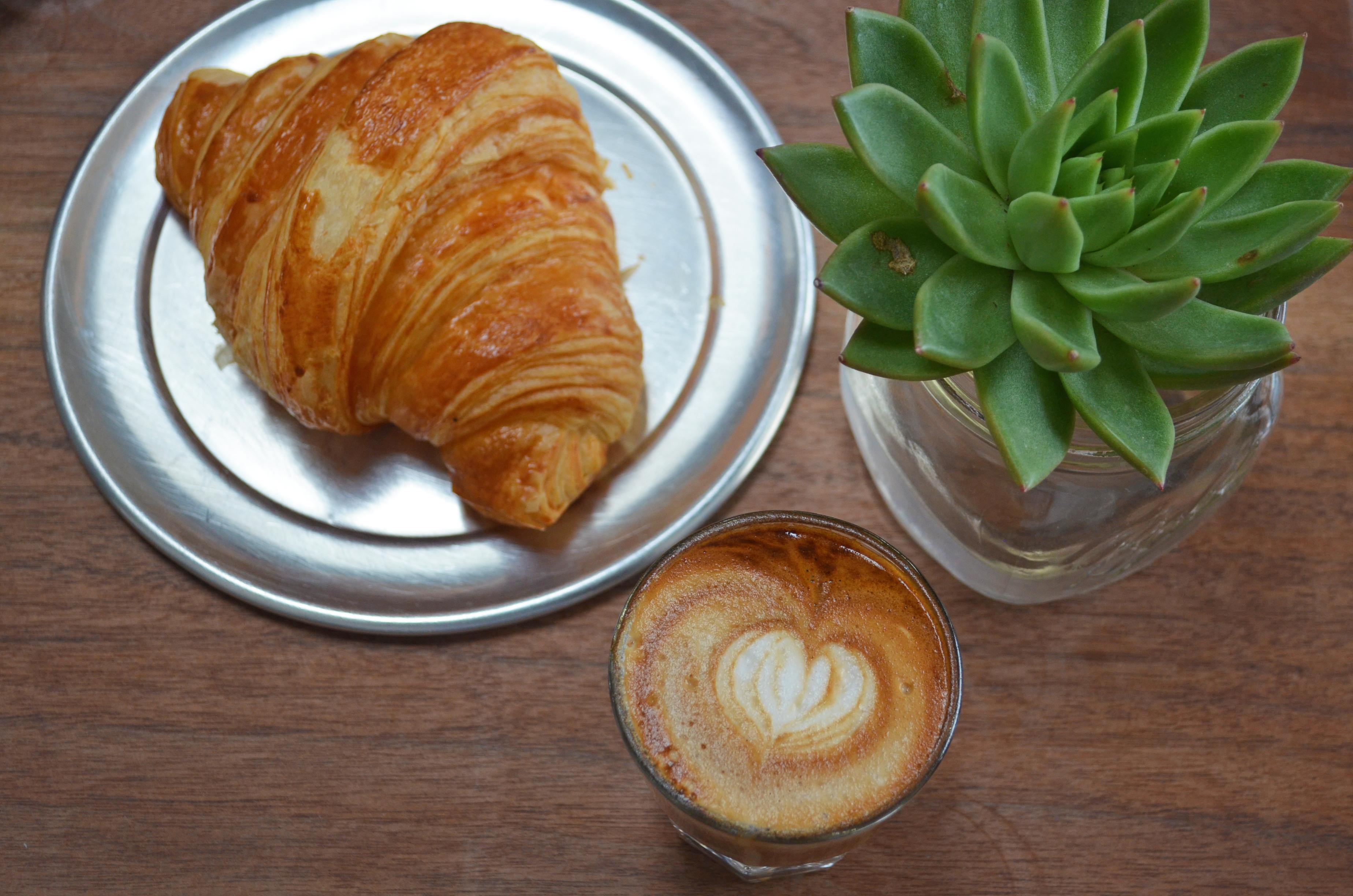 Courtney Scott Bushwick AP Cafe Croissant and succulent